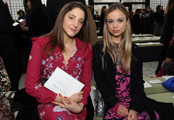 Lady Amelia Windsor in a fuschia pink and black patterned dress.