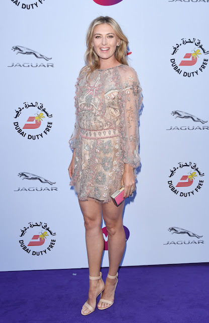 Maria Sharapova stunning leggy poses at WTA party carpet photo 2