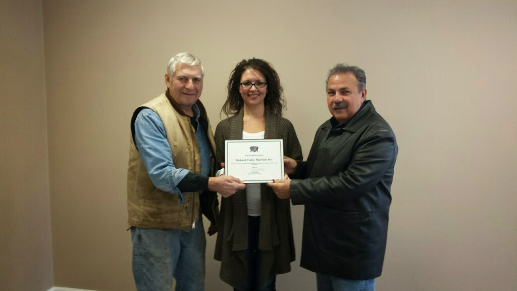 Tricia Rutkowski, President of Mohawk Valley Materials, receives the Beautification award from Sonny Candella and David Tucci of the Marcy Chamber of Commerce Board.