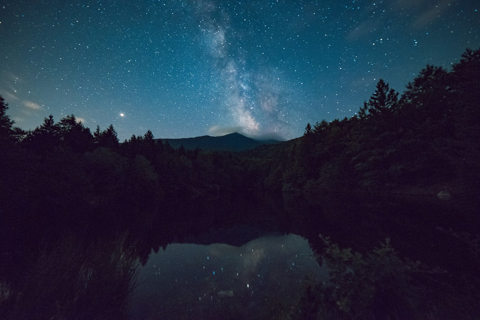 4k Wallpaper Calm Waters Dark Scenic View of Forest During Night Time
