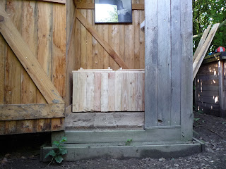 finished homemade dry toilet form pallets