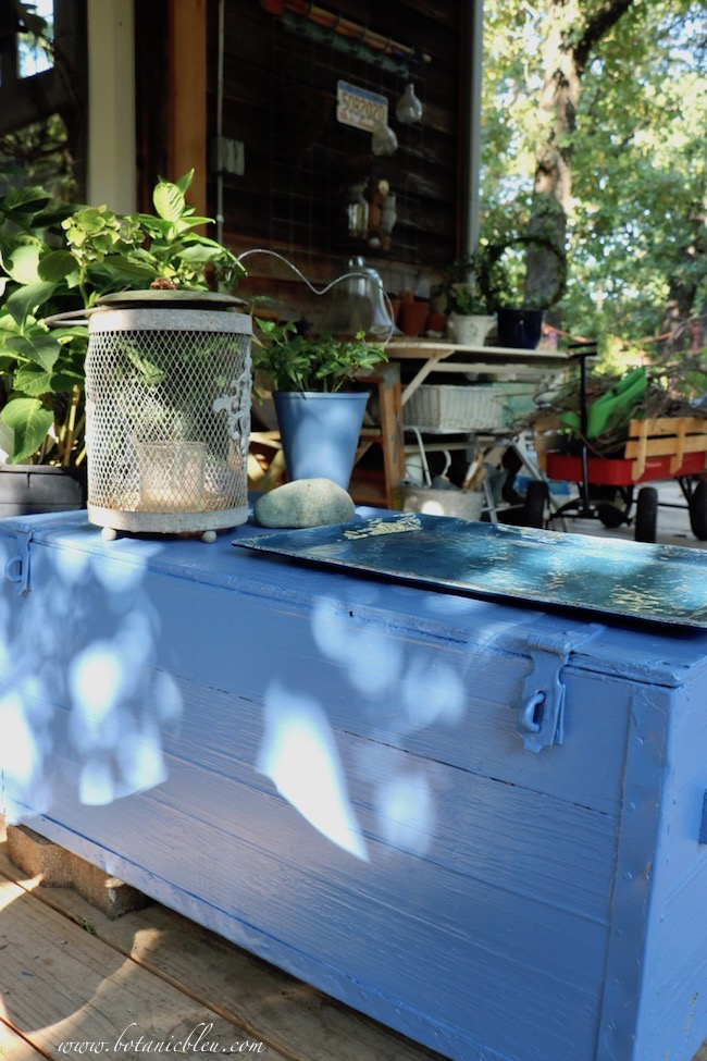 After allowing primer paint to dry twenty four hours, a coat of exterior blue paint was applied to the rustic box