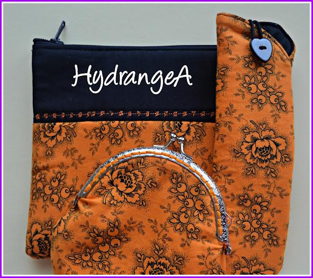 Monedero con boquilla, funda de gafas y neceser en tela de algodón naranja y negra