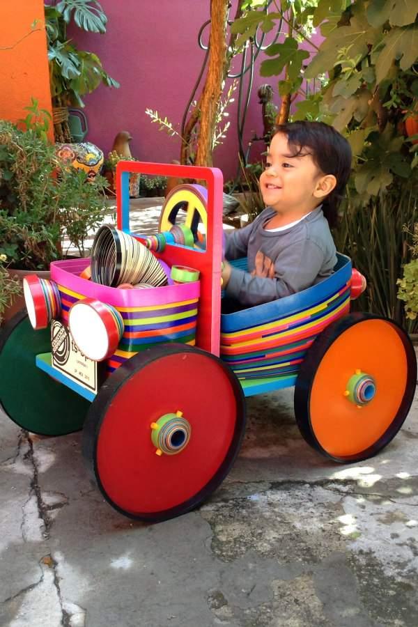 little boy sitting in paper car