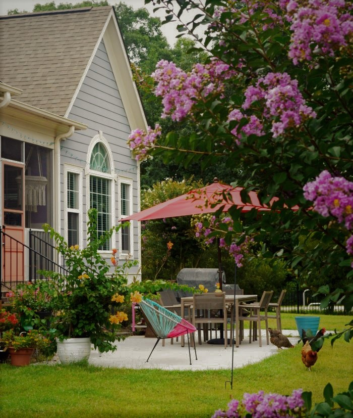 Outdoor patio brimming with plants and flowers-designaddictmom