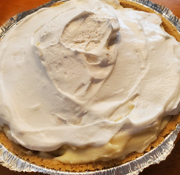 this is a banana cream pie in a graham cracker crust