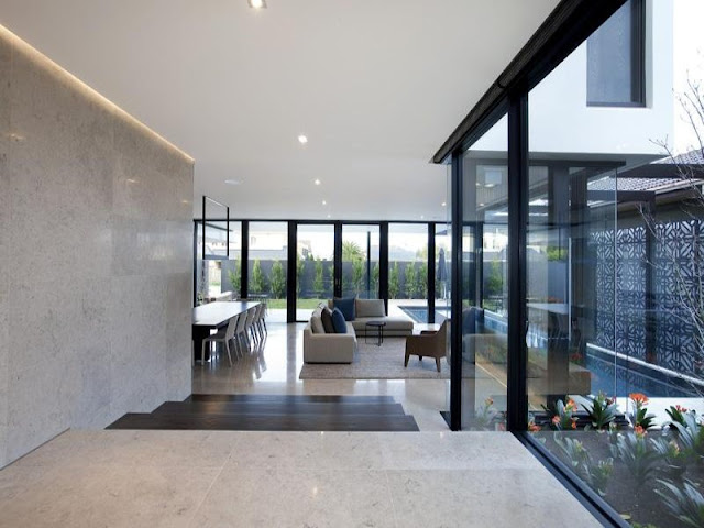 Photo of hallway leading into living room of amazing modern home in Melbourne