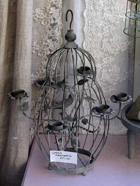 Candle holder cage, shop window, via Goldoni, Livorno