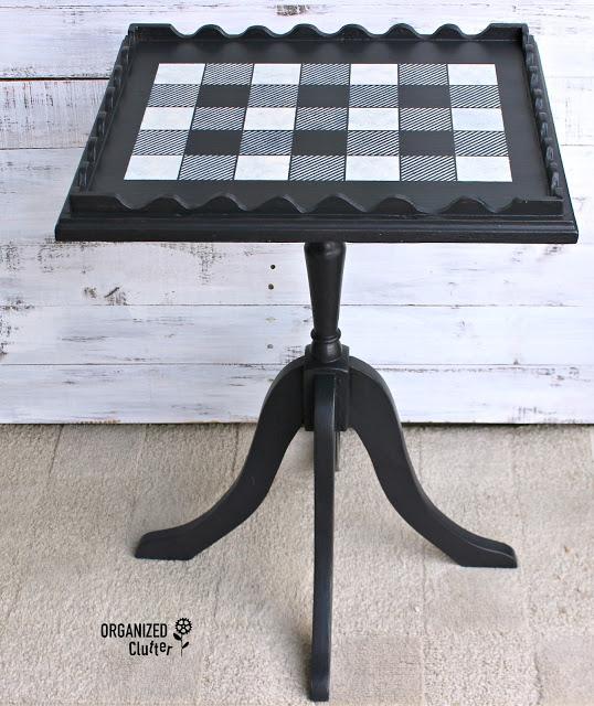 Photo of a pedestal table stenciled with buffalo checks