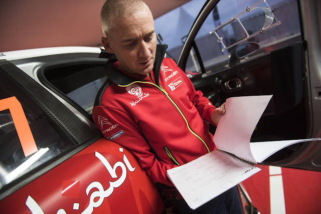 Co-driver Paul Nagle studies his pace notes