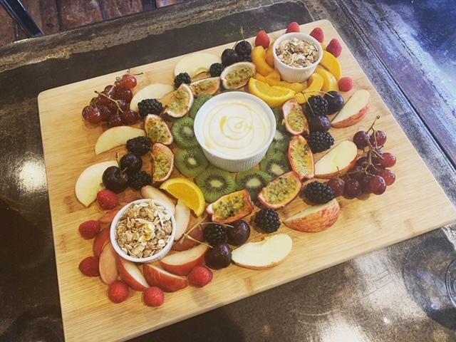 Fruit medley platter board, with Greek yogurt and granola pots