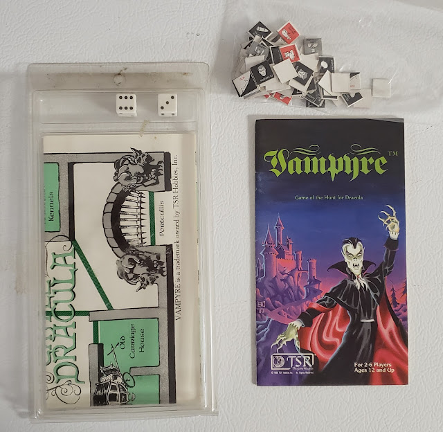 Vampyre minigame in clamshell, with dice, counters and map