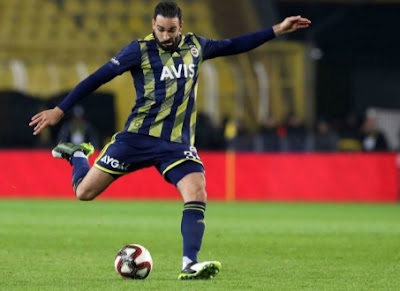 Adil Rami playing football for his team