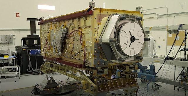 "OCO-3 sits on the large vibration table (known as the ""shaker"") in the Environmental Test Lab at the Jet Propulsion Laboratory. Credit: NASA/JPL-Caltech"