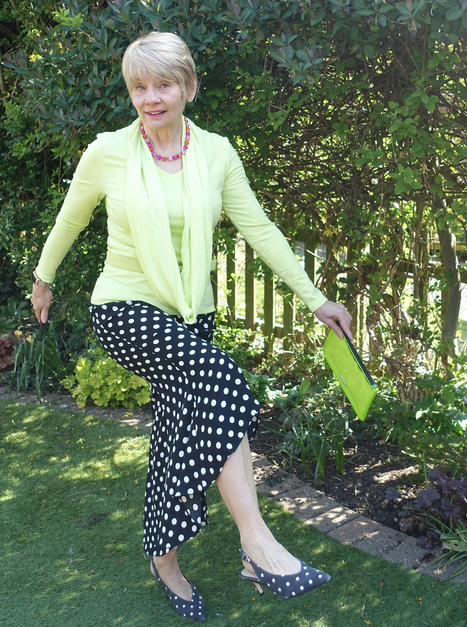Gail Hanlon from Is This Mutton in acid yellow and black polka dot trousers and shoes
