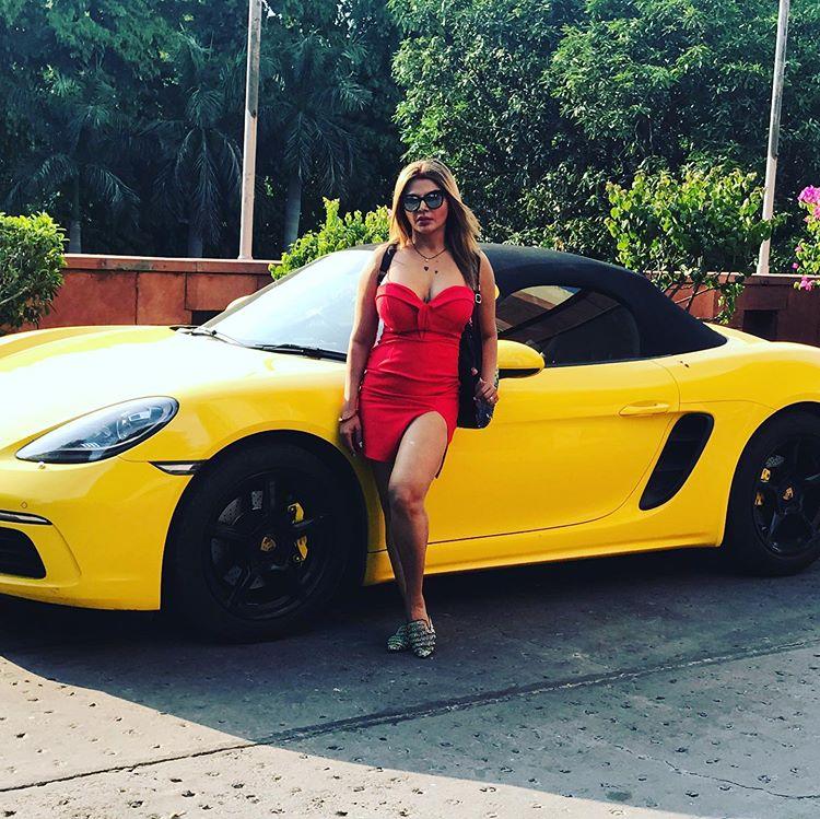 Car Lovely sexy look Short Dress Rakhi Sawant Hot Photoshoot pic