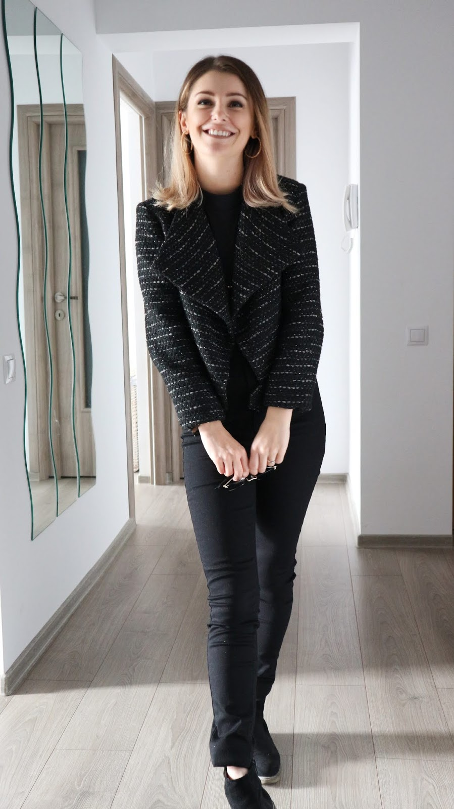 black style with tweed jacket and black jeans