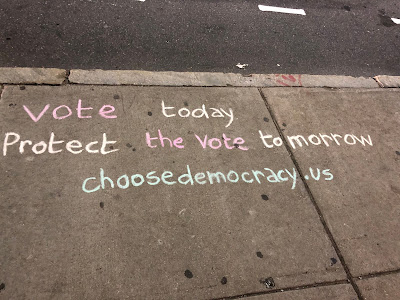 Writing on sidewalk Vote today/Protect the vote tomorrow/chooseemocracy.us