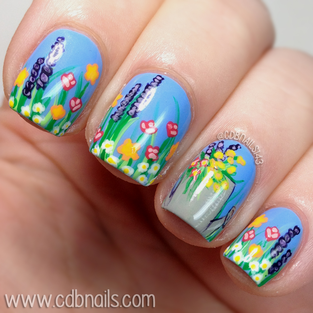 Cdbnails 40 great nail art ideas spring i decided on a garden inspired mani since flowers blooming are the first sign of spring i started out with a sky blue base and free hand painted everything prinsesfo Choice Image