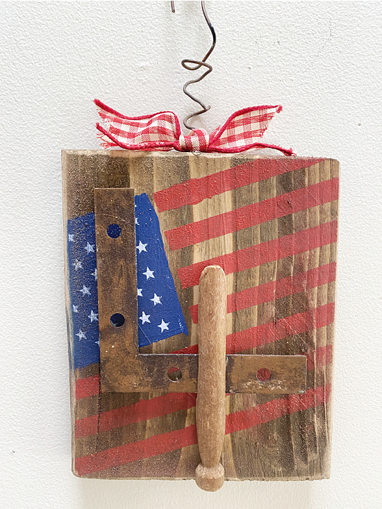 Scrap wood flag with junky 4 on it