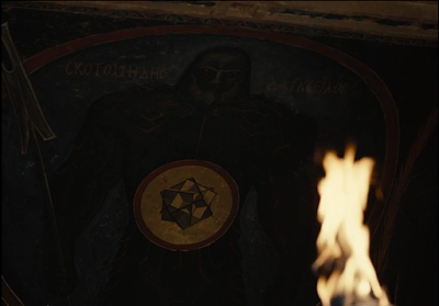 Shot of a painting on a wall of Darkseid and the Unity in an ancient Greek style