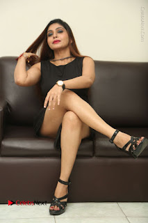 Tollywood Upcoming Actress Pooja Roshan Stills in Black Short Dress at Plus 1 Movie Trailer Launch  0295.JPG