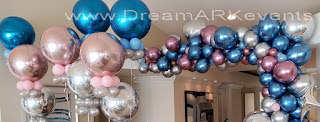 Organic balloon arch with chrome balloons