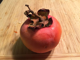 Persimmon on cutting board