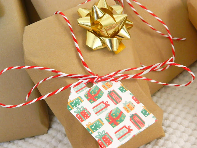 A close up photo of a christmas present wrapped using brown paper and string