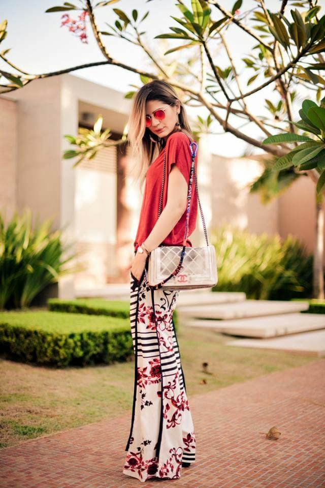 O modelo de óculos de sol redondo da Ray Ban está invadindo o guarda-roupa  de todas as blogueiras cb96e137c6563