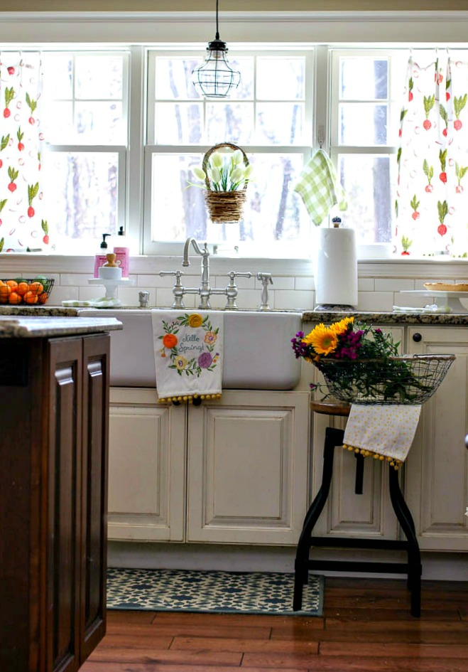 Lots of pops of color for spring in kitchen with farmhouse sink and flour sack curtains
