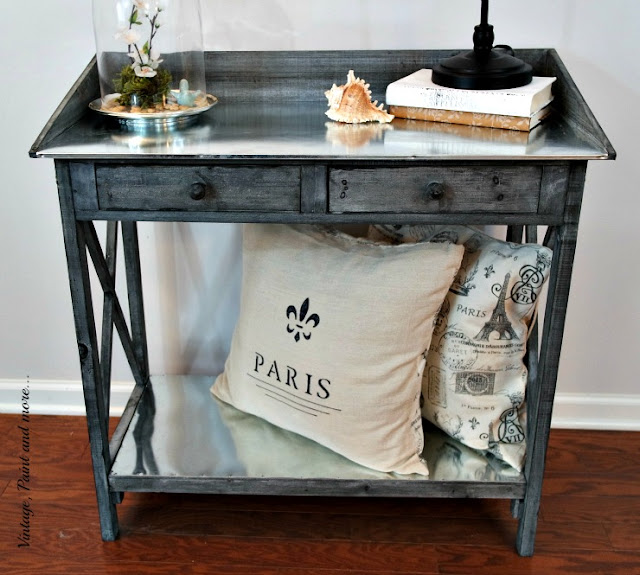 a vintage potting bench used as side table
