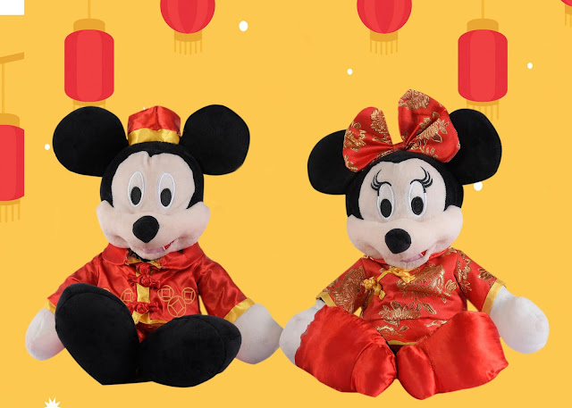 Mickey and Minnie Mouse in their Chinese inspired costumes.