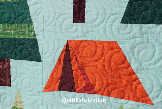 orange tent on a blue green fabric background on The Great Outdoors quilt by QuiltFabrication