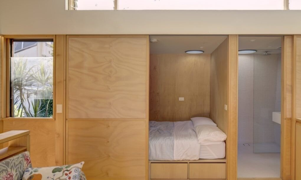 10-Sliding-Panels-to-Bedroom-and-Bathroom-M-W-Architects-Sustainable-Architecture-with-the-Garage-Top-Studio-www-designstack-co