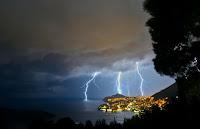Lightning over city - Photo by Stefano Zocca on Unsplash