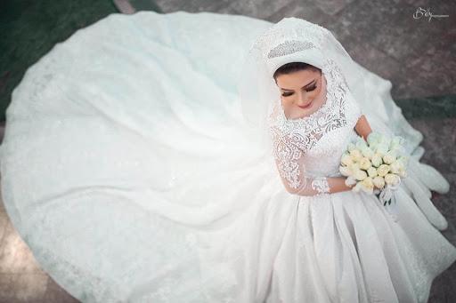 فساتين زفاف اتلية هتجوز Hatgawez - عباس العقاد