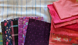 Purple and pink fabrics on the blue and white background fabric