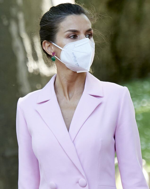 Queen Letizia wore a pink double breasted flared blazer dress coat, and pink clutch and pumps by Magrit. Tous jewelry earrings