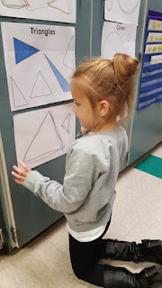 Student tracing triangle while kneeling Teach Magically