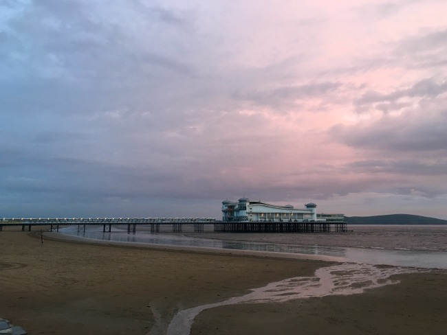 Mini-Breaks-and-Den-Building-Weston-super-mare-sunset-over-grand-pier