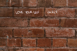 Brick with love yourself message