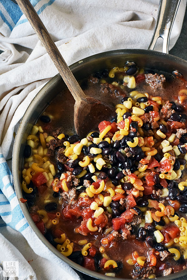 Add black beans, corn, tomatoes, salsa, elbow noodles, and water for One Pot Taco Pasta Recipe