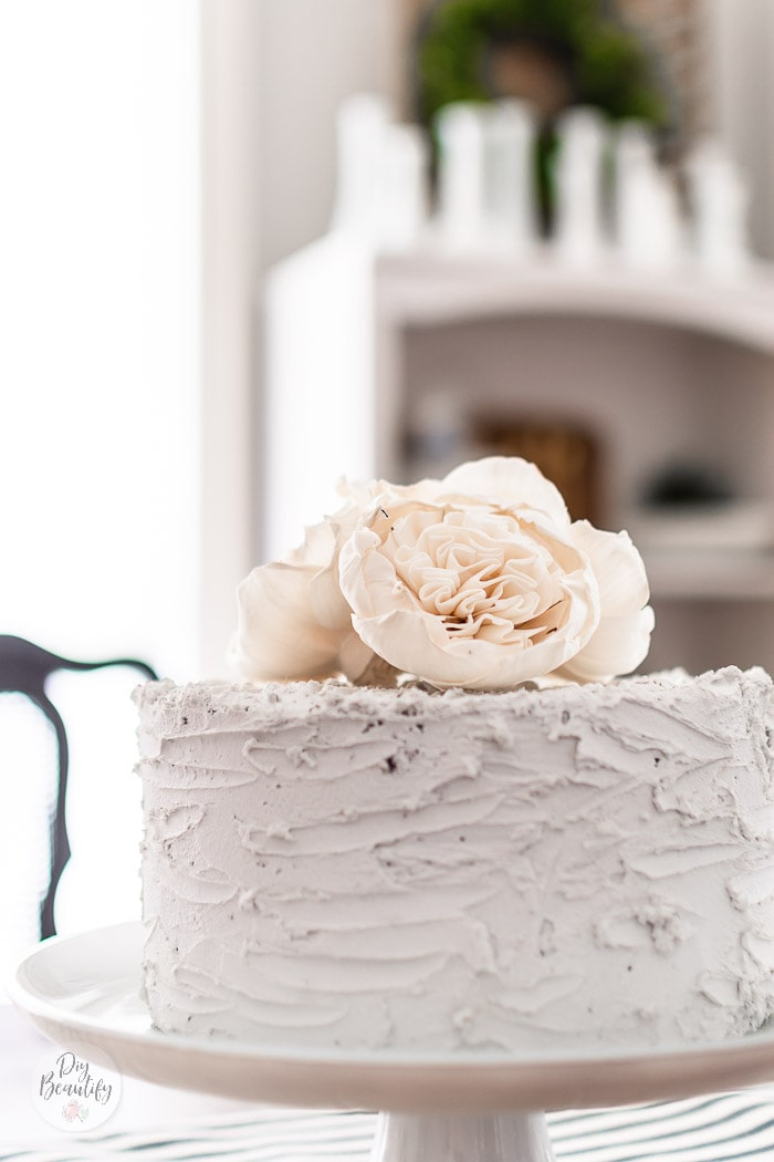 close up of fake cake and white wood flowers