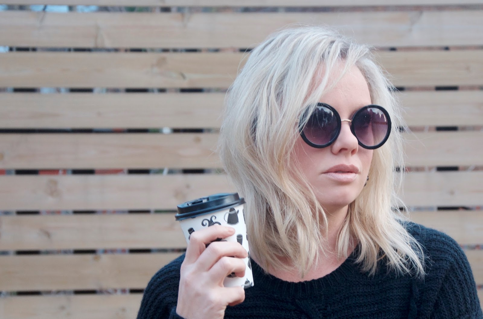 Black Sunglasses and Black & White Disposable Coffee Cup