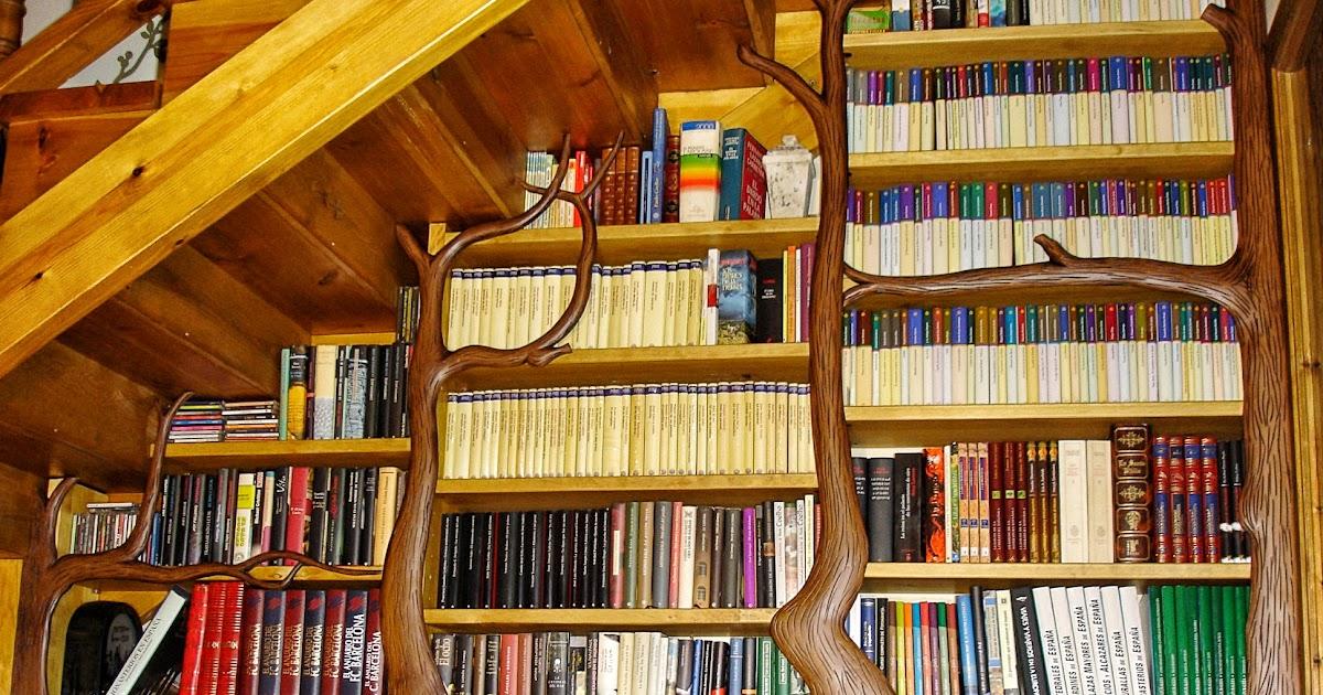 Carpinteria sevilla librer a con pilastras de troncos de - Libreria de madera ...
