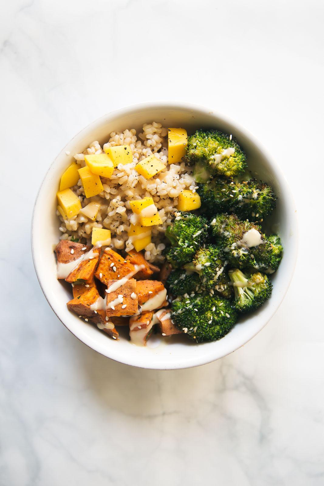 Vegan Sweet Potato Buddha Bowl with Orange Sesame Almond Butter Dressing #vegan #vegetarian #bowl #orange #potato