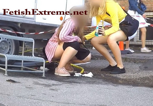 Public pissing at an outdoor carnival (Carnival_0018)