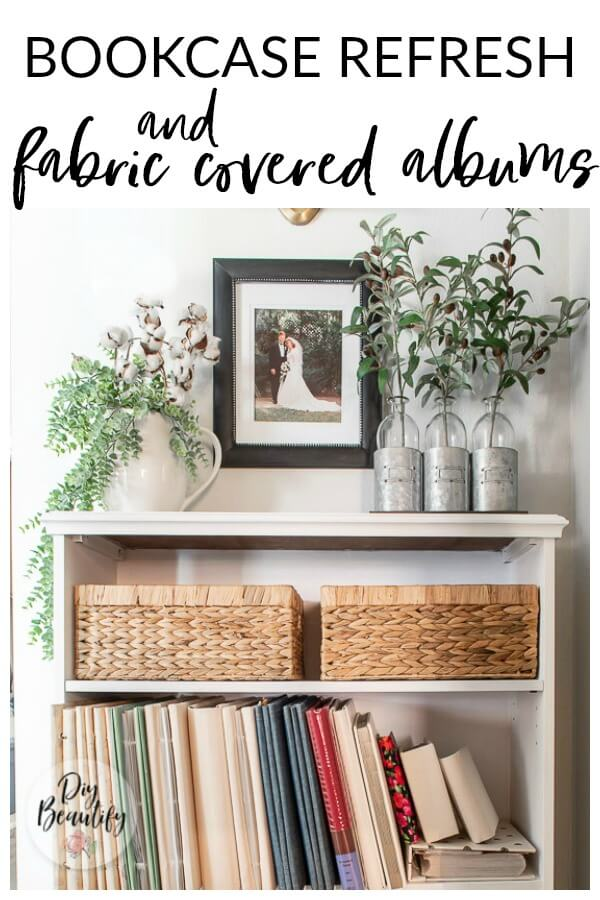 white painted bookcase and neutral fabric covered albums
