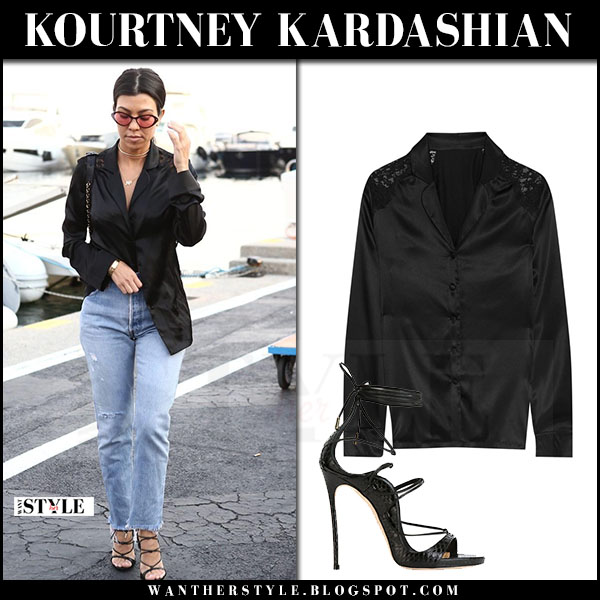 Kourtney Kardashian in black silk blouse id sarrieri and jeans re/done what she wore may 25 2017 cannes